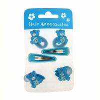 Barrettes clic clac et élastiques nounours bleu