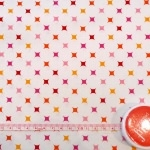 Tissu Diamants rose / orange / rouge
