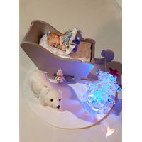 Bébé fille Reine des Neiges dans son traineau - au cœur des arts