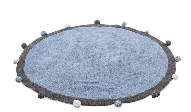 Le tapis rond à pompons