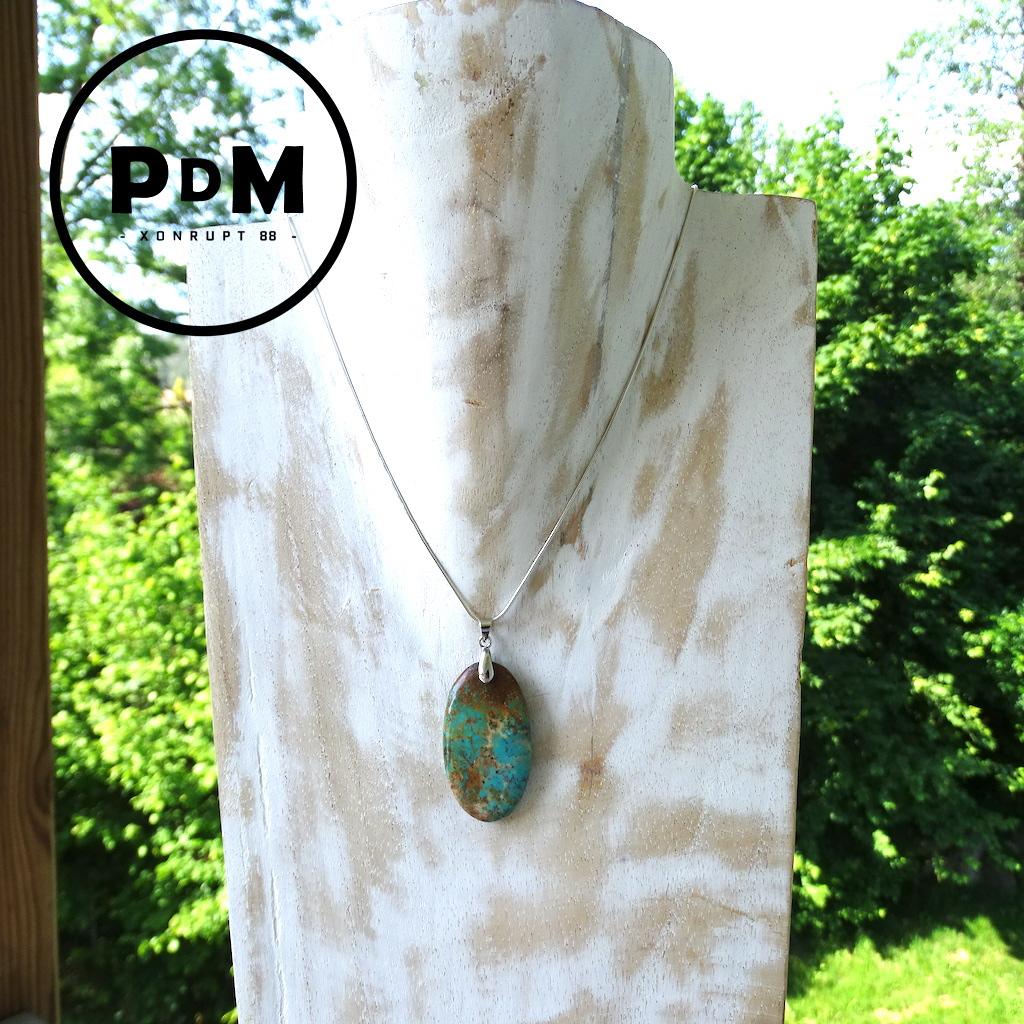 Pendentif Turquoise semi brut en pierre naturelle forme allongée avec bélière acier