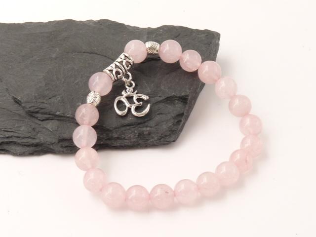 Bracelet boule 8mm Quartz rose avec symbole Ohm