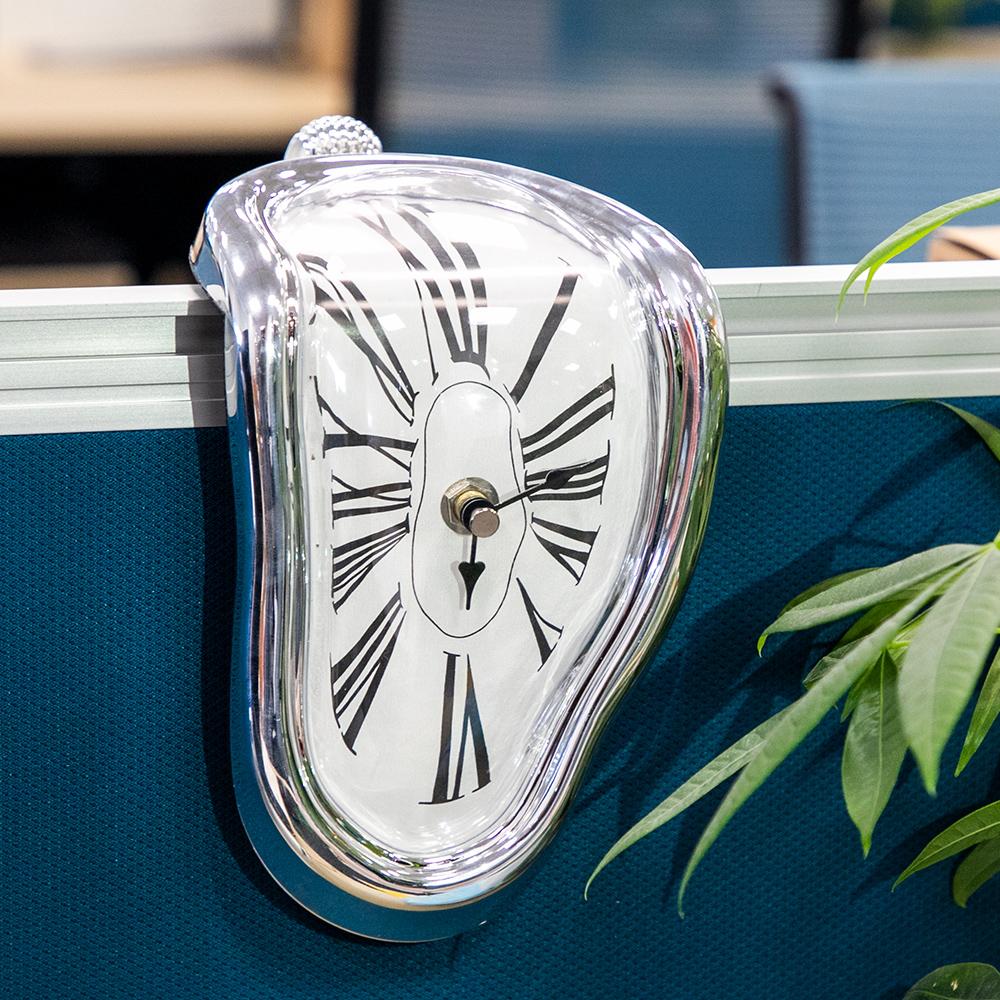 Horloge déformée style Dali 18 cm