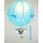 lampe montgolfière bleu et beige polaire turquoise allumée