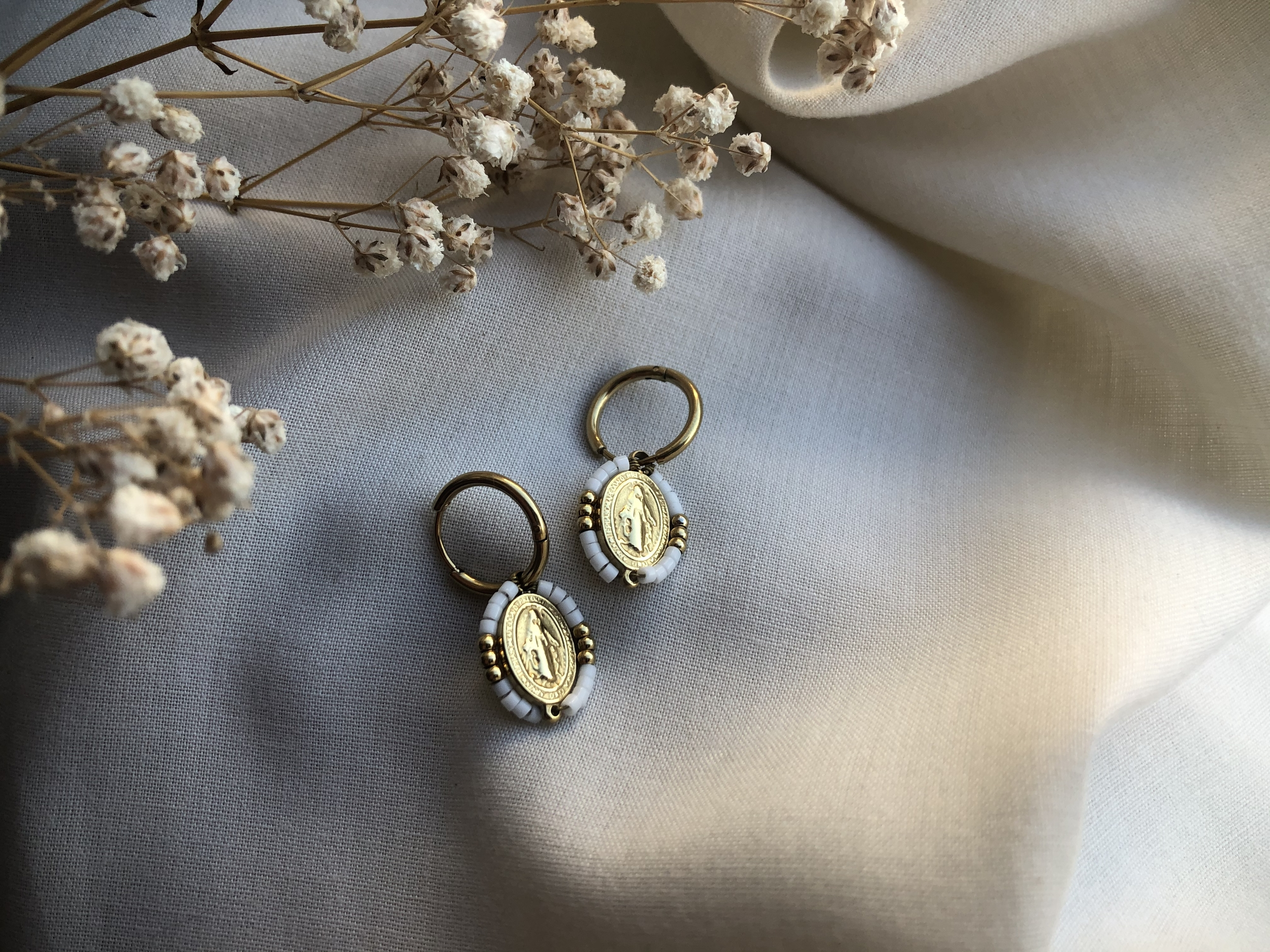 Boucles d\'oreille White miracle