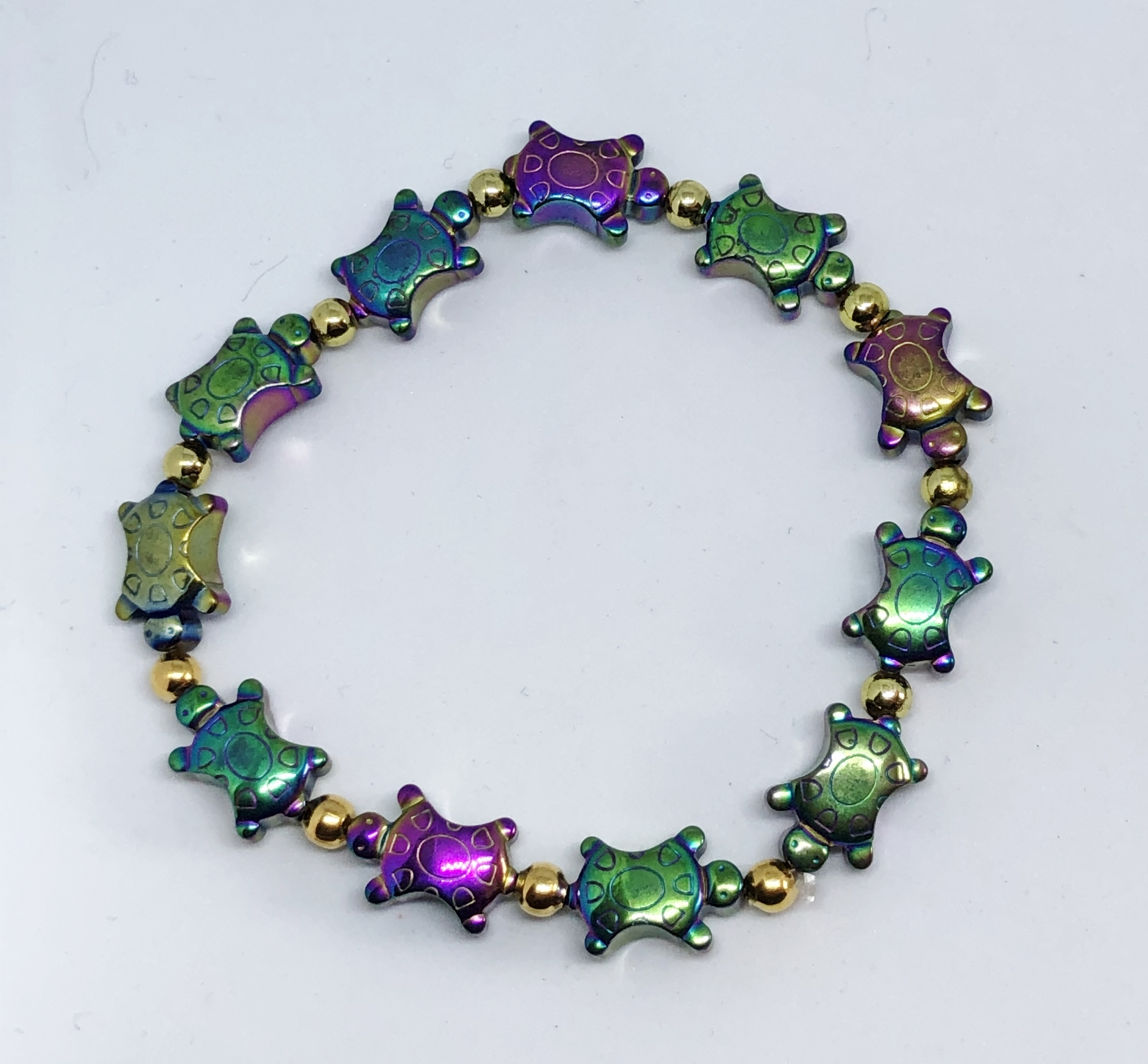 Bracelet tortues rainbow hématite non magnétique - Angel shop