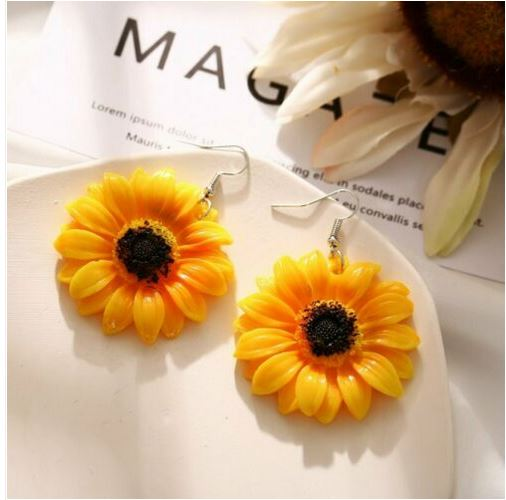 Boucles d\'oreilles maguerites XXL résine orange crochets - Angel shop