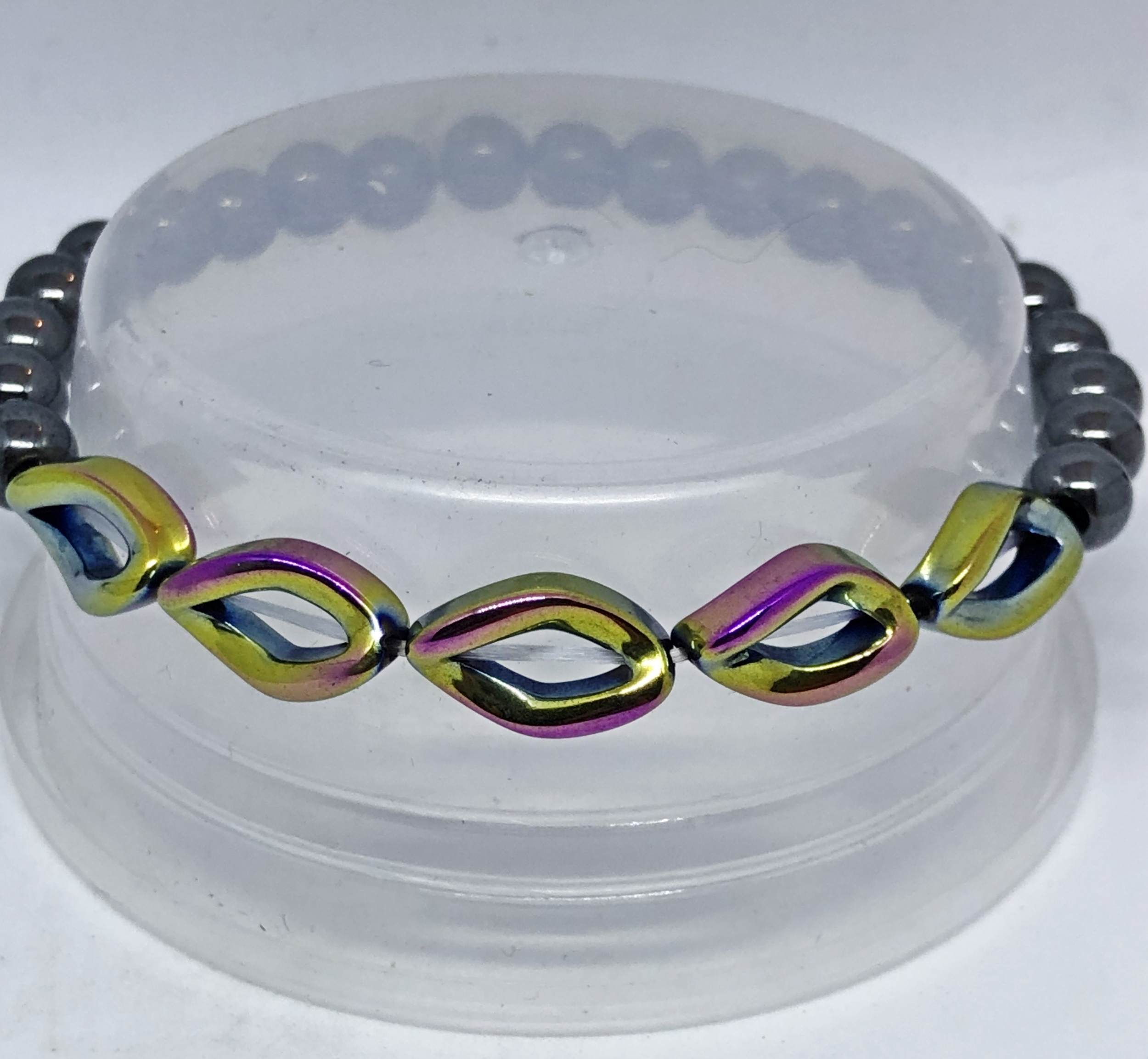 Bracelet forme coquillage en hematite non magnetique rainbow - Angel Shop