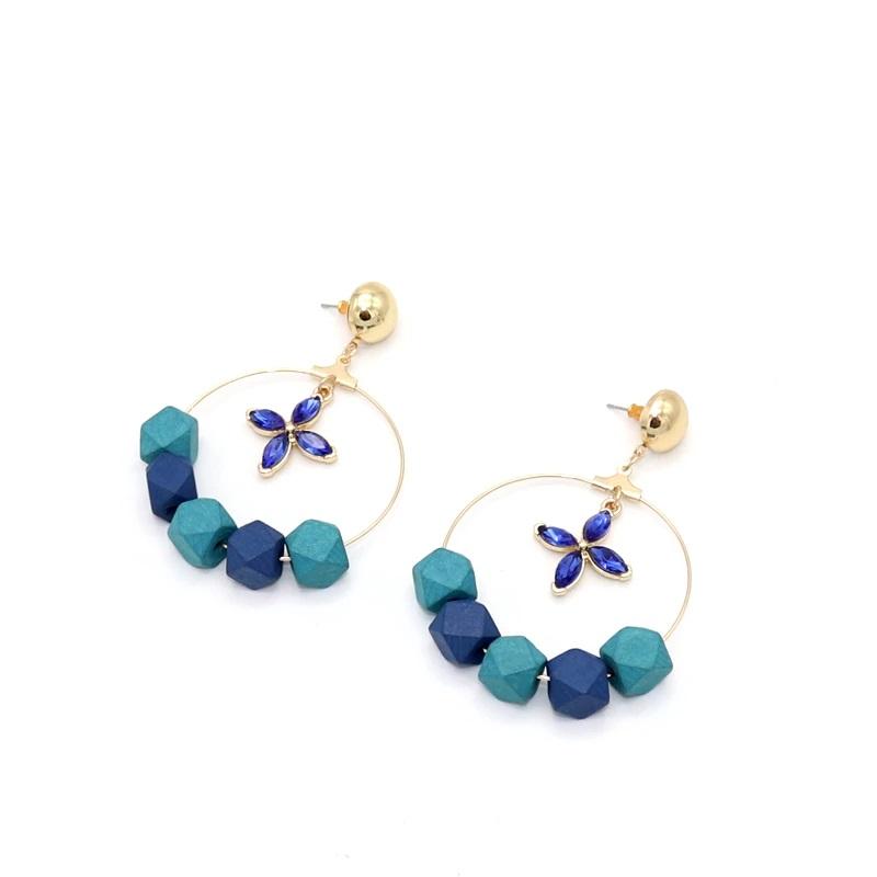 Boucles d\'oreilles bois - Fleur bleue