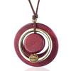 sautoir avec pendentif cercles en bois et métal rose