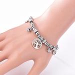 bracelet en acier arbre de vie et breloques