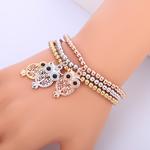 3 bracelets à breloques avec hibou