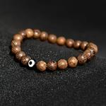 Bracelet perles de bois bon oeil