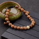 Bracelet perles de bois strass