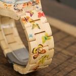 montre en bois femme butterfly details