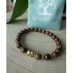 Bracelet avec perles en bois et éléphant doré
