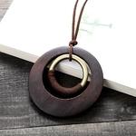 pendentif rond en bois et métal style bohème