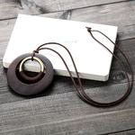 pendentif en bois et métal style bohème