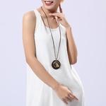 long collier femme avec pendentif en bois et oiseau