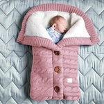 nid d ange bebe en laine rose