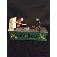 Tirelire mécanique hockey