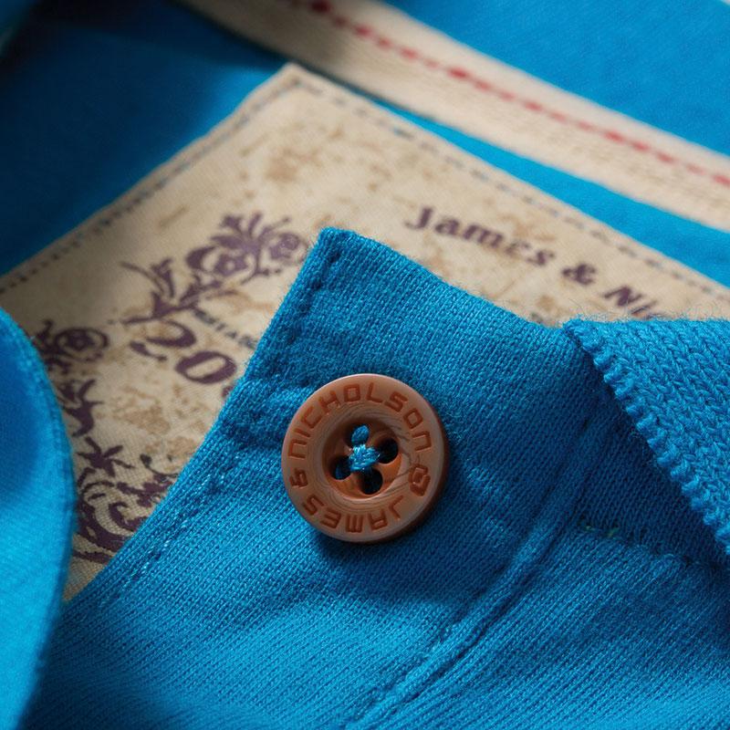 Polo_uni_Femme_turquoise_detail_bouton_col_JN940