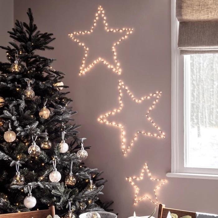 étoile lumineuse noël a poser 80 leds blanc chaud  or et rose vendue sur deco-lumineuse.fr