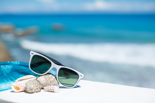White-Sunglasses-And-Seashells-Blue-Sea-Summer-Vacation