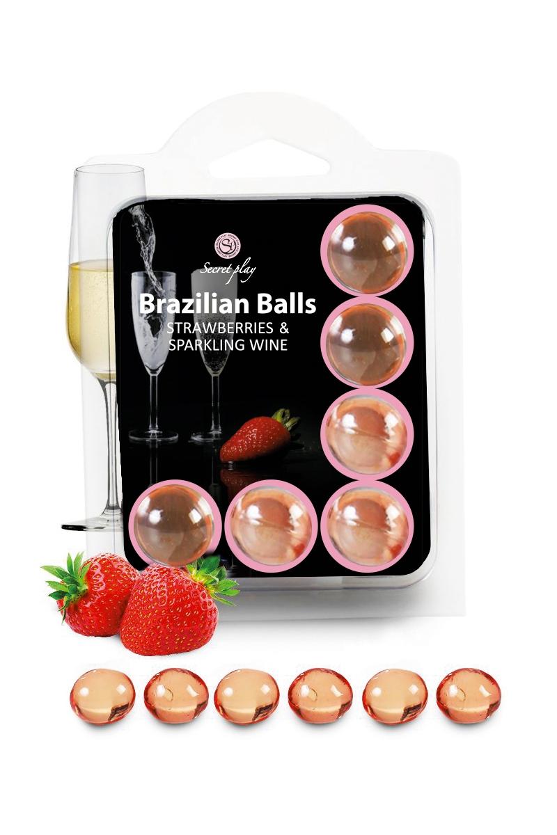 Boules lubrifiantes parfum fraise et champagne, se dissolvent sur le corps, 6 boules au total vendue chez oohmygod