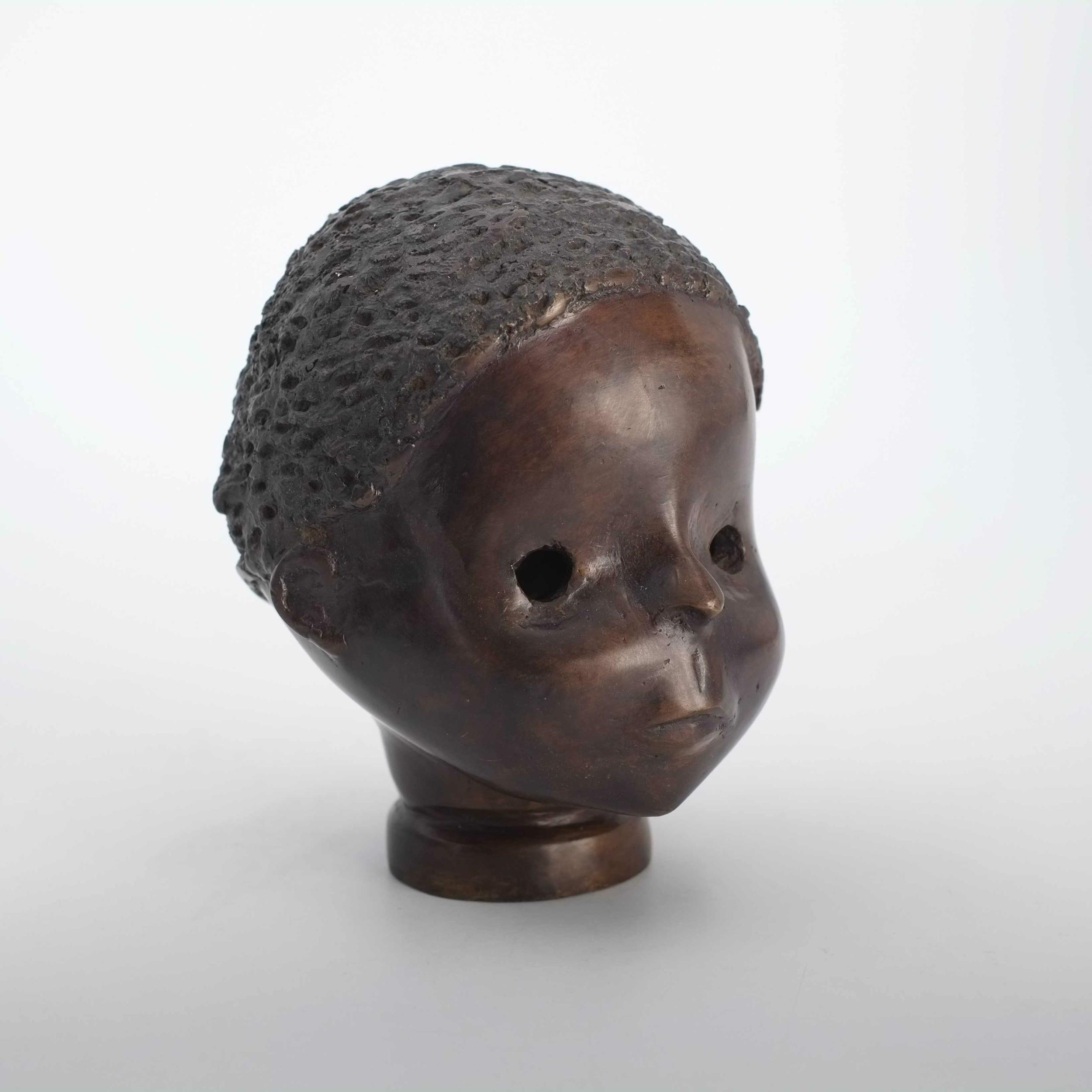 Tête de poupée en bronze du Burkina Faso