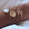 3 bracelets dorés feuille opale St Germain