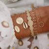 bracelets breloques jonc doré bohème chic