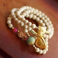 Bracelet perle palourde blanc strass bouddha rieur