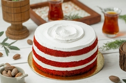 red-velvet-cake-with-white-whipping-cream-glass-tea_114579-3711