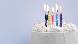 birthday-cake-with-candles-blue-background_23-2148351969