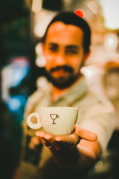 focus-photography-of-man-holding-ceramic-teacup-733761