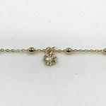chaine - bracelet de cheville en plaqué or 3 microns chaine boules et 4 pendentif trèfle à 4 feuilles