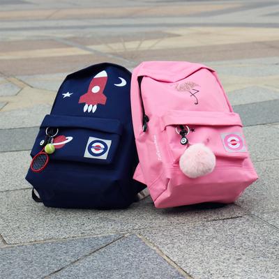 sac-a-dos-garcon-bleu-fusee-rose-fille-flamant