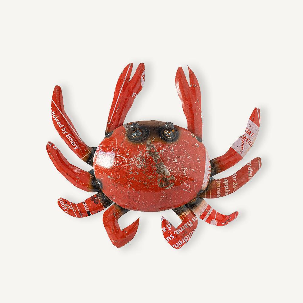 Petit crabe en métal rouge