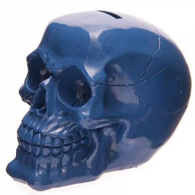 Tirelire crâne poli bleu
