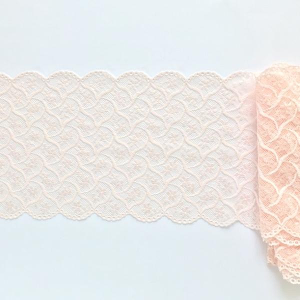 Dentelle en galon motif graphique rose-pêche