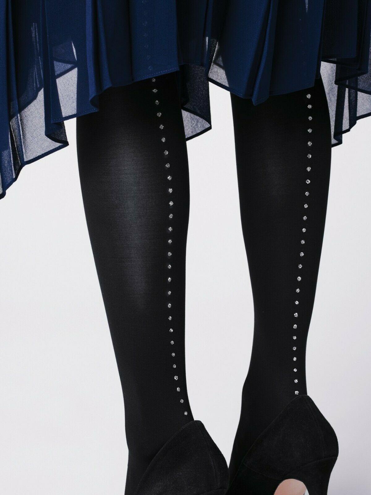 Collant opaque avec petits points brillants qui descendent le long de la jambe