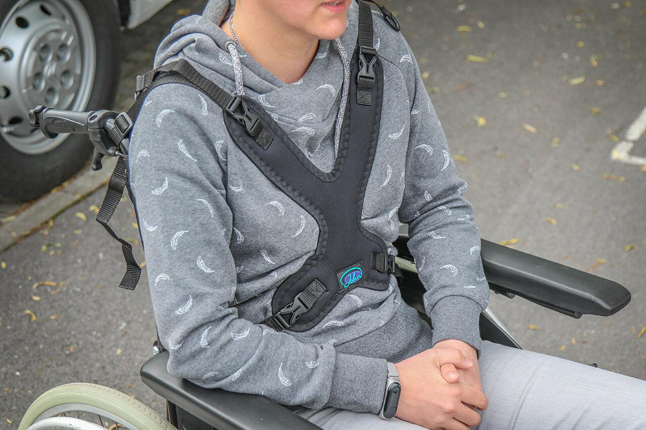 Harnais de maintien pour fauteuil roulant