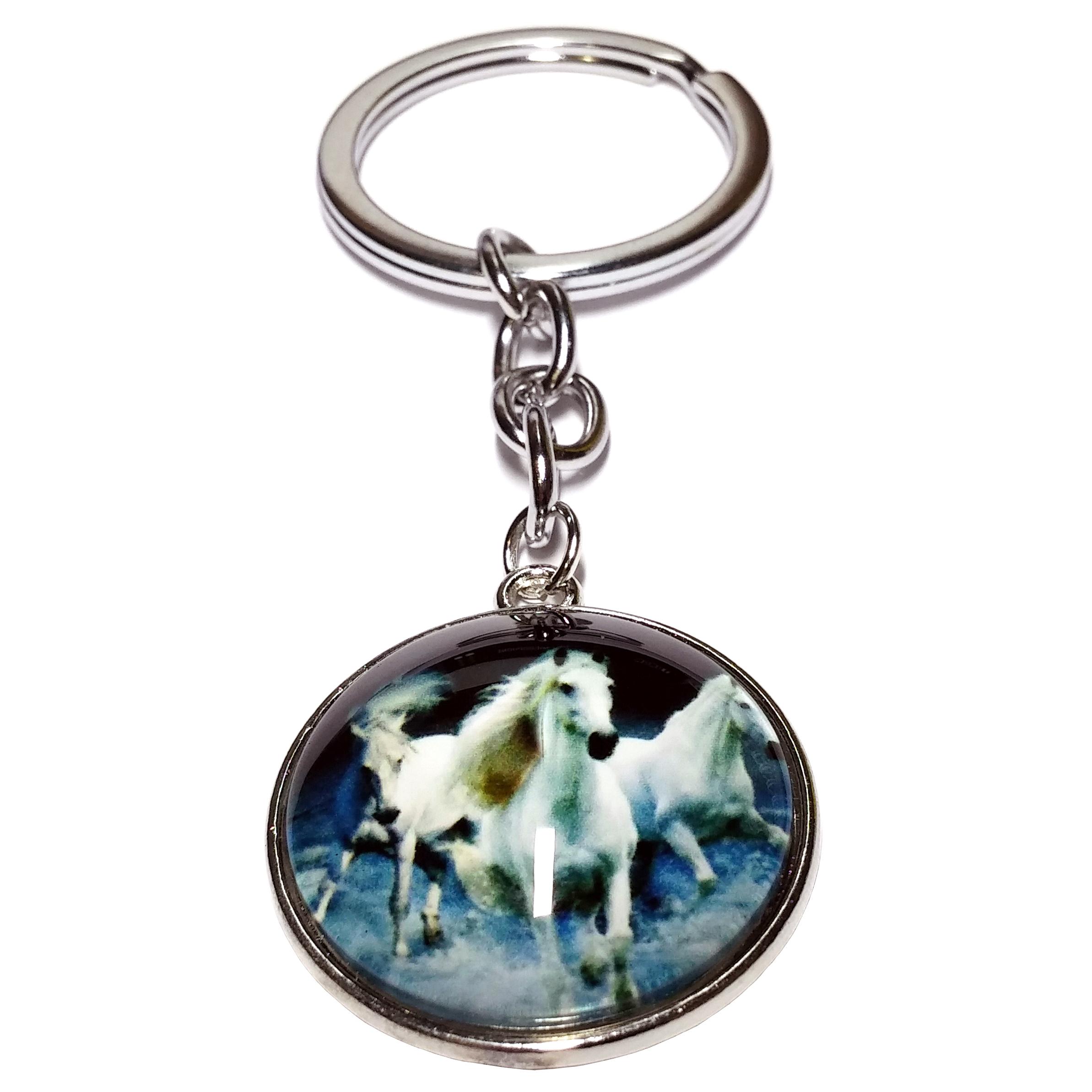 Porte clé métal chevaux blancs aux galops