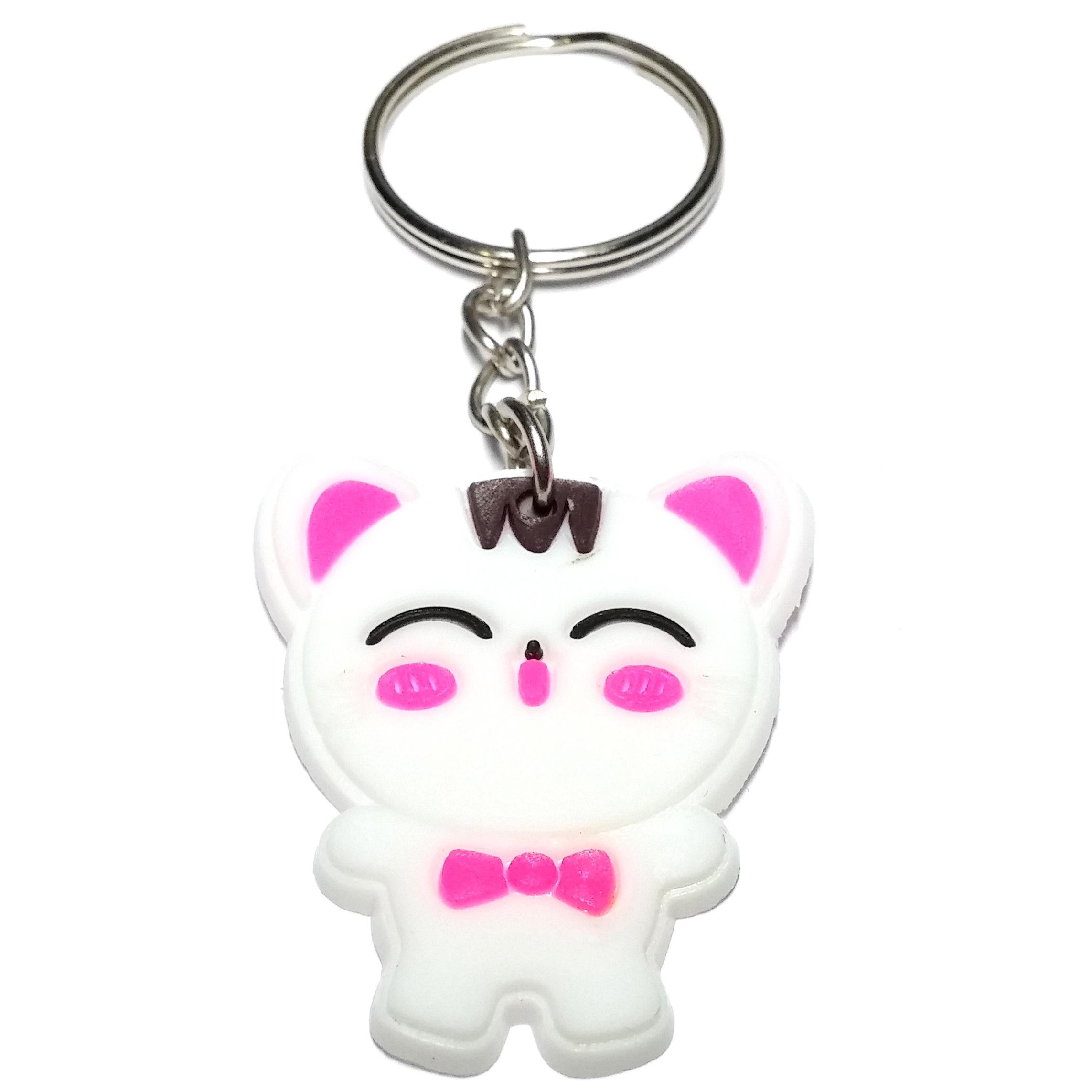 Porte clé plastique chaton blanc avec un noeud papillon rose