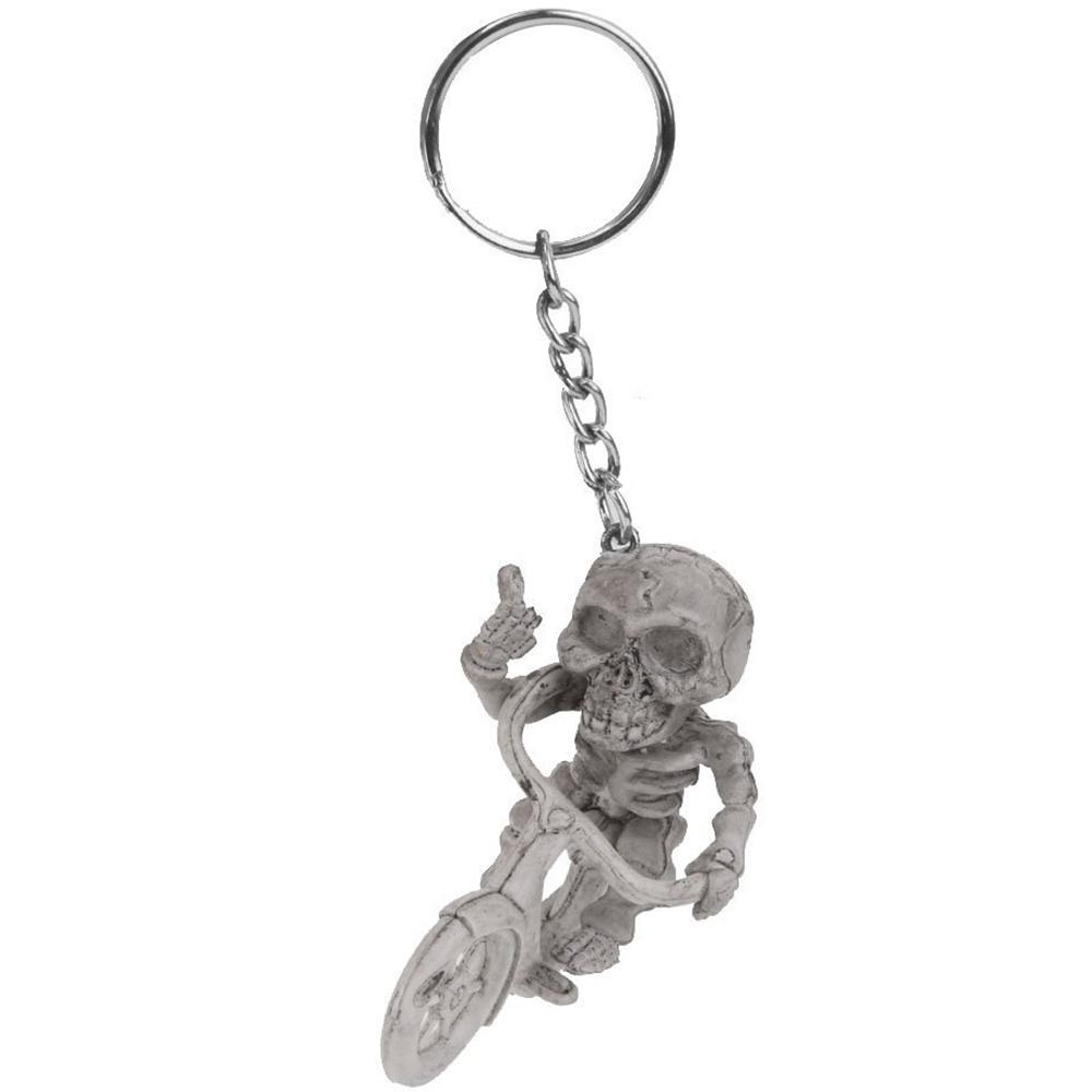 Porte Clé Squelette Sur Un Vélo