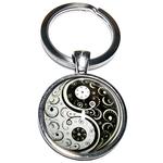 Porte clé en métal yin yang stylisé
