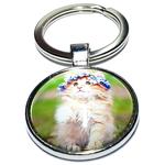 Porte clé métal chaton avec une  couronne de fleur bleu