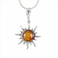 Pendentif soleil 2.8cm de diamètre, ambre cognac & argent,  hauteur 4.4cm