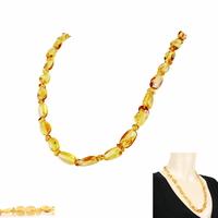 Collier ambre miel/doré avec inclusions forme olives, longueur 60cm